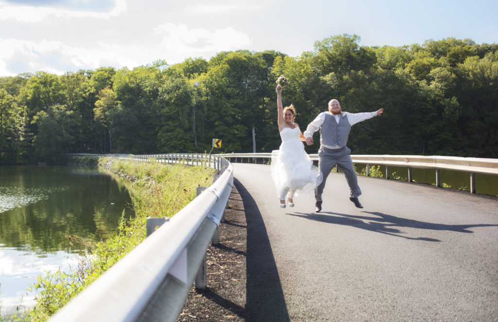 bride and groom jump